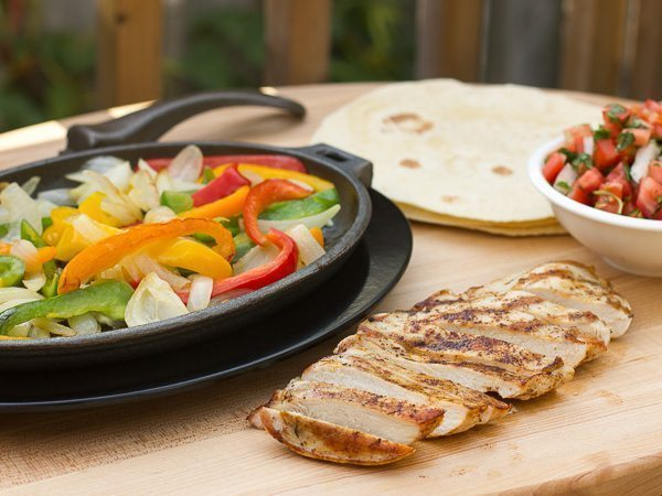Grilled chicken and ingredients for fajitas
